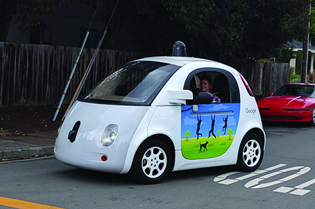 Google self-driving car with a human passenger