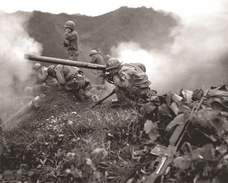 Rifle being fired during the Korean War