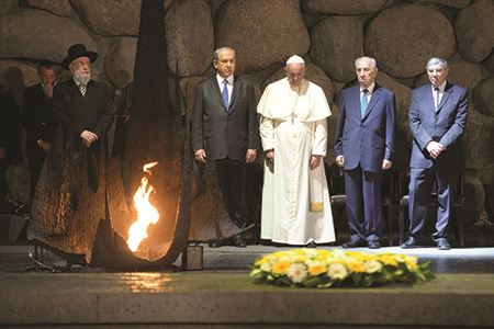 Pope Francis praying at the Hall of Remembrance at the Yad Vashem Holocaust Memorial